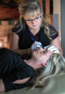 Cori doing permanent makeup